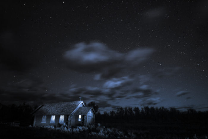 4. This picture of Church of the Transfiguration is surreal with the light from the stars and within the church in contrast to the darkness of the night.