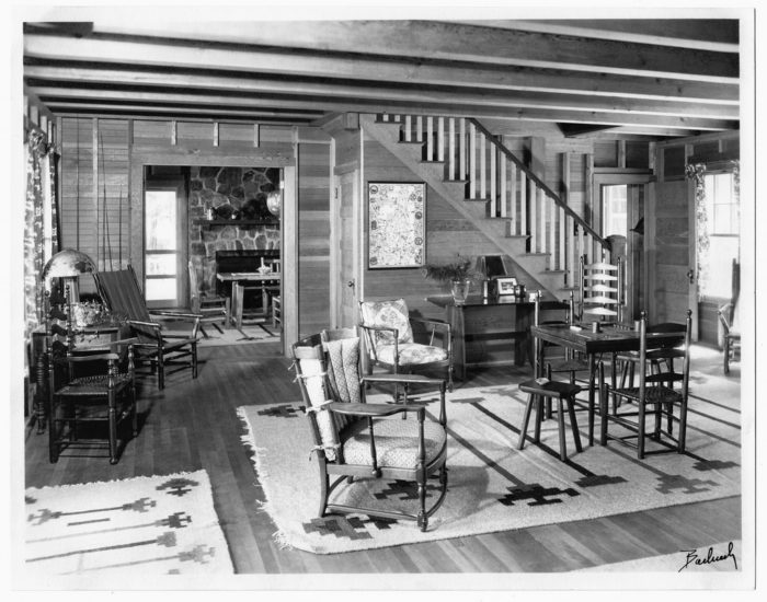The living room of a New Hampshire cabin in the mid-1900s looks like the rustic cabins of today.