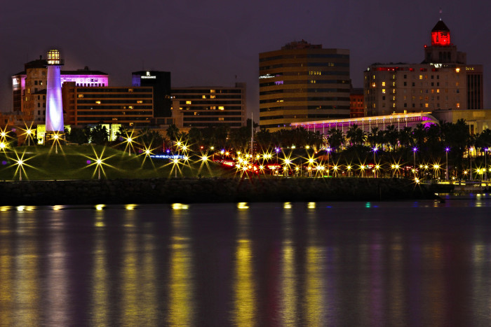 7. The city lights in Long Beach cast a magical glow across the water.