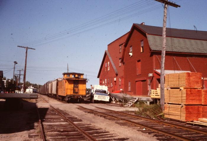 6. The MEC caboose trailing through Wisscaset, September 1977.