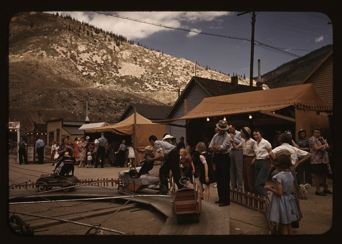 11. Families spending quality time together at the Delta County Fair, Colorado.  (1940)