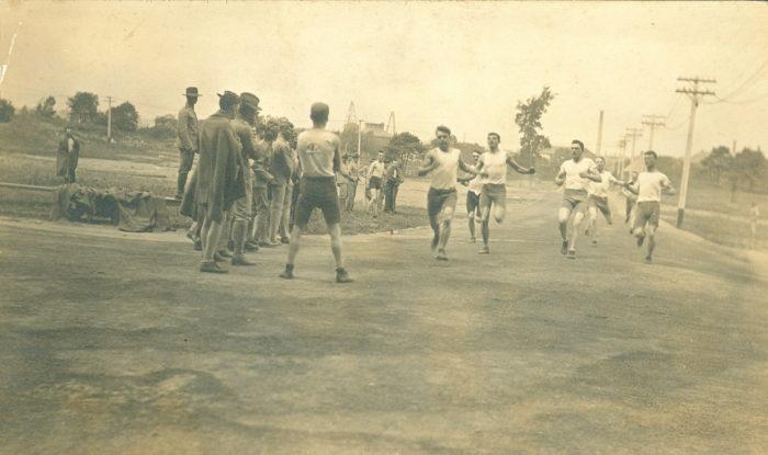 6. Young men in Portsmouth run a 440-yard dash.