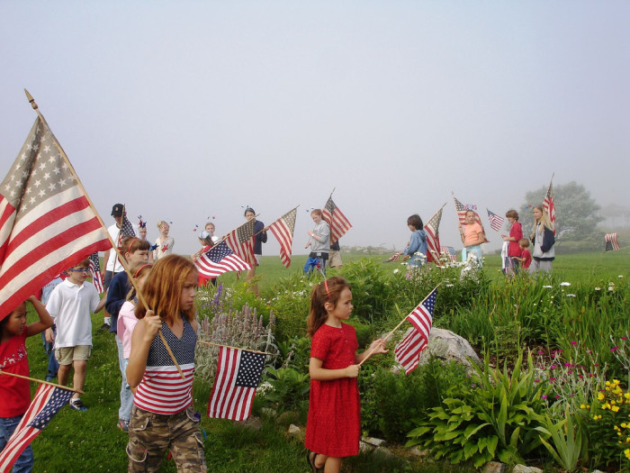 13. These kids in Rockingham have Patriotic spirit, even if the weather on the Fourth of July is disappointing.