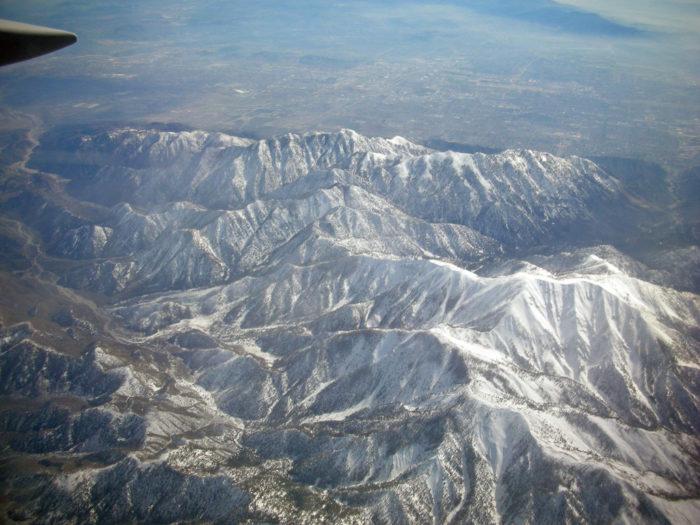 4. Anyone for an awe-inspiring flight over the Rockies?