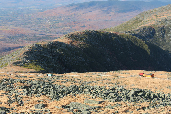 On its climb to the summit, the Cog Railroad passes three miles along the western flank of Mount Washington, offering riders sweeping views of the presidential range.
