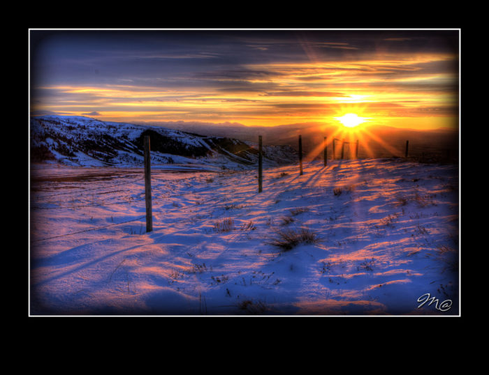 2. The rays radiating from this sleepy sunset cast a beautiful glow on the snow. This captivating view is from Casper Mountain.