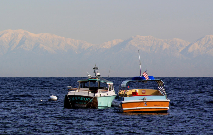 3. Boats in the ocean with a view of the SoCal mountains off in the distance covered in snow is so rare and so beautiful.