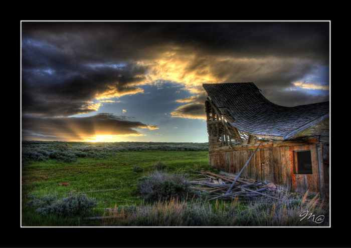 9. The sunset is shining its final light on this old mountain cabin located between Casper Mountain and Muddy Mountain. This is postcard perfect!