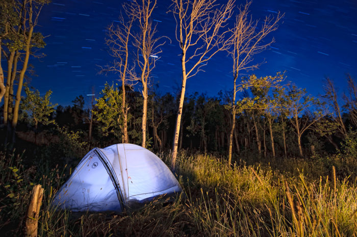 10. The light from within the tent and the light from the campfire create a magical setting in Vedauwoo. The sky even looks like it's filled with shooting stars as an added bonus.