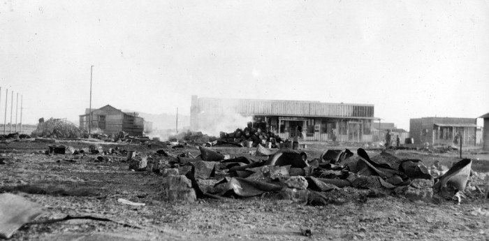 13. However, on March 9th 1916, Pancho Villa crossed the border with a group of guerrilla fighters and attacked Columbus. They burned the town and killed 19 people. This is what the town looked like after the raid.
