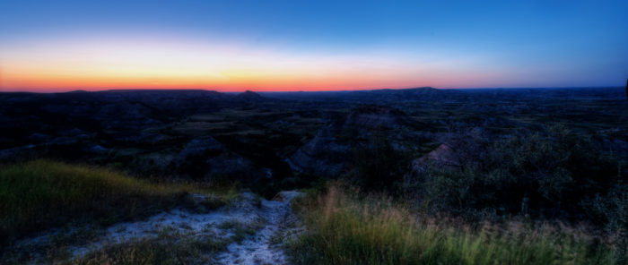 1. Shadows of the badlands in Theodore Roosevelt National Park under the dark yet colorful sky creates an awesome effect here.