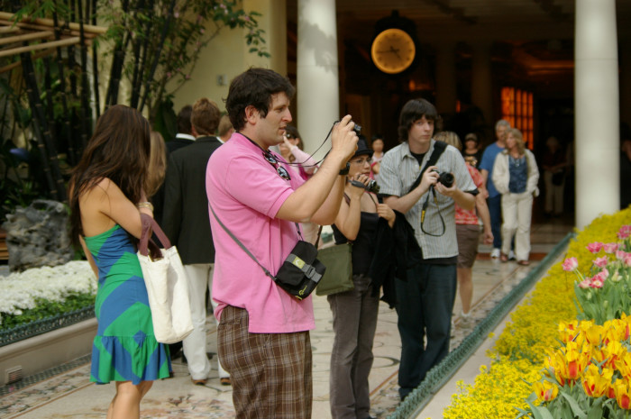 7. Tourists are often spotted with a camera around their neck, capturing their beautiful surroundings.