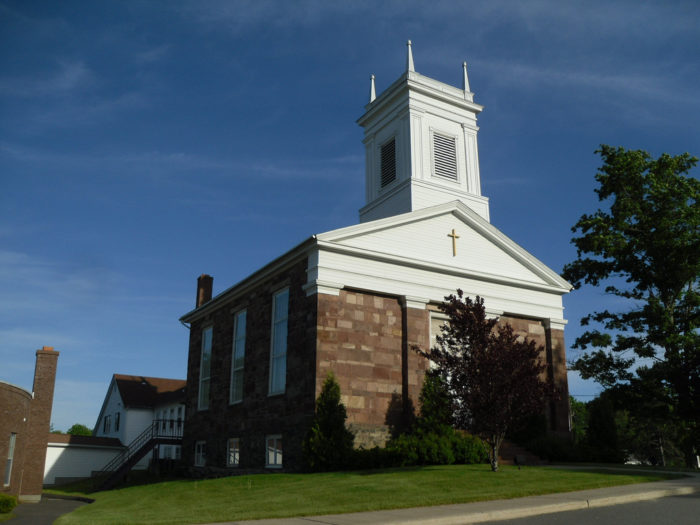 9. This simple church in East Granby is beautiful with its white top and long windows.