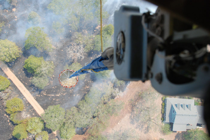 11. Remember the devastating Bastrop fires? This is a shot from a helicopter delivering a (huge) bucket of water in hopes to aid in putting out the fires.