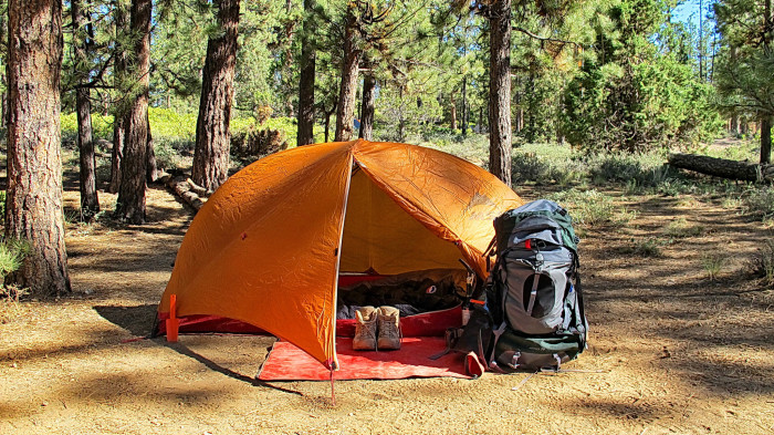 3. Sleep in a tent.
