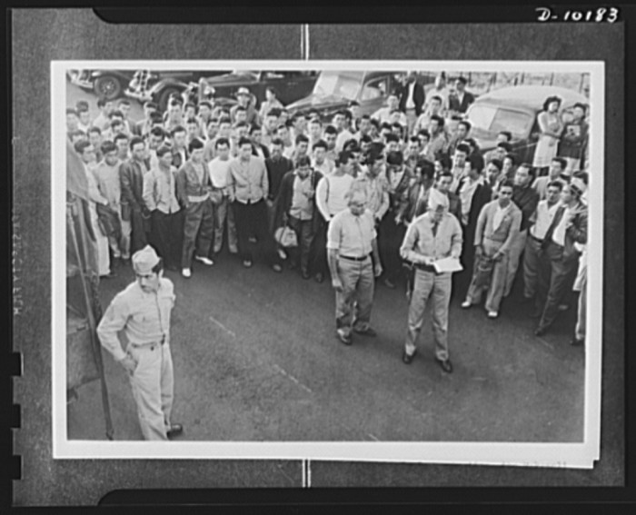 8. Japanese-American volunteers on Kauai waiting for their physical examinations and standing for roll call of the Makaweli draft board registrants.