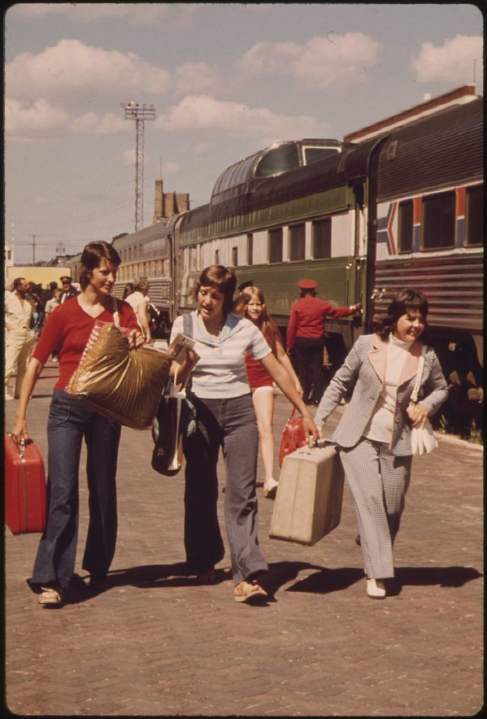 1. Passengers on a train heading west stop at the station in Fargo - 1974