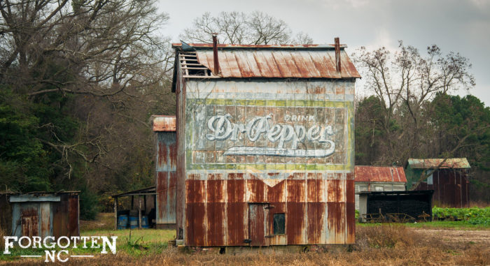 3. A vintage Dr. Pepper sign adds retro charm to this old barn.