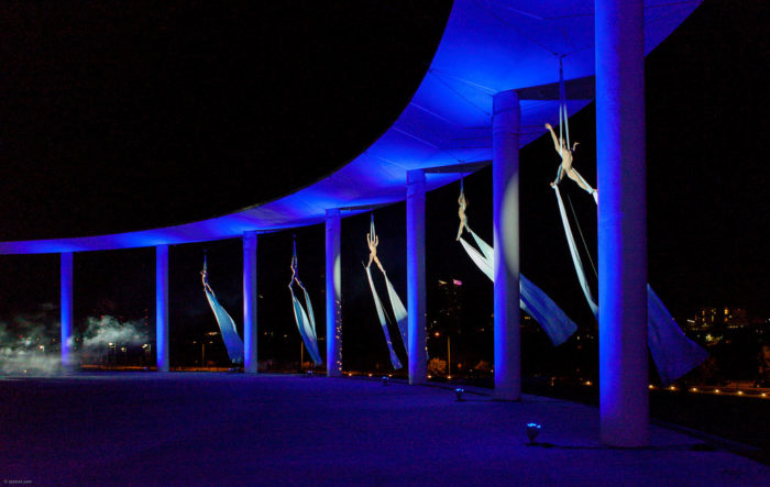13. Aerial dancers performing at the Long Center with a distant view of the city in the background. Beautiful!