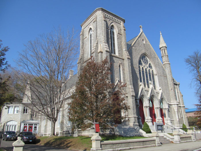 7. Quantity meets quality in Meriden. This church has multiple peak and tower like parts.