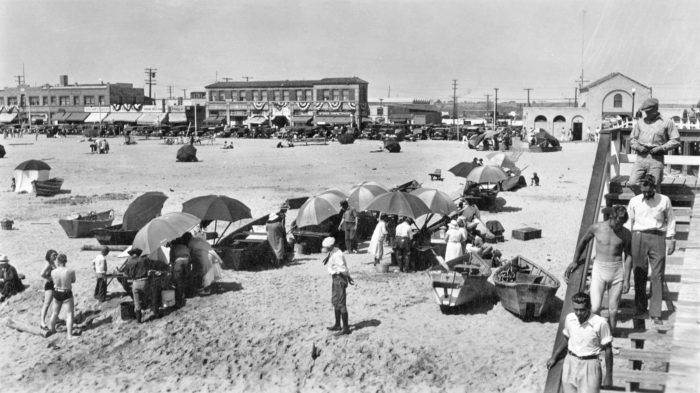 12. Local folks hanging out at the beach under umbrellas and doing a little shopping at the Newport Pier fish market.