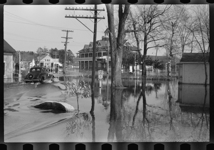 4. The homes in the background of this photo were victims to the Sebago Lake flood of 1936.