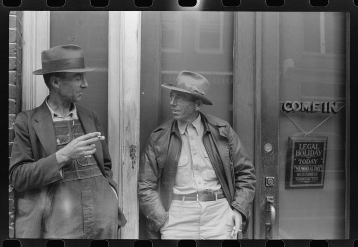 10. Two farmers in Roxboro stop on Main Street for a smoke and a midday chat.