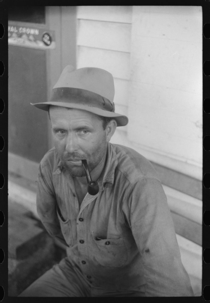5. A worker at the grading station in Belcross. His hopes are to find a 20 cent/hour job and one day have a 100-acre sweet potato farm.
