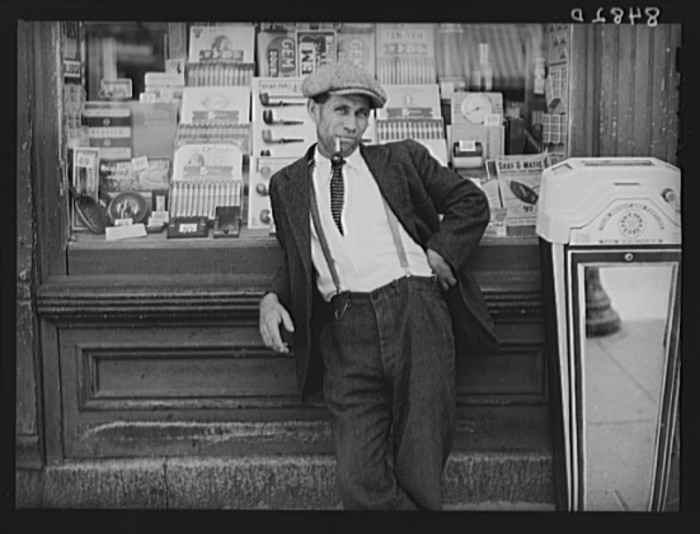 5. A local gent hangs out in front of a drug store in Dover in 1938. You could pick up a pack of smokes, a box of cigars or a prescription from your doctor at the local drug store.