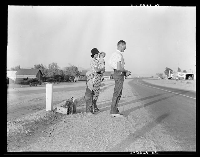 1. This Oklahoma farm family stands by the highway between Blythe and Indio. Forced by the drought of 1936 to abandon their farm, they set out with their children to drive to California. Picking cotton in Arizona for a day or two at a time gave them enough for food and gas to continue. On this day, they were within a day's travel of their destination, Bakersfield, California. Their car had broken down en route and was abandoned.