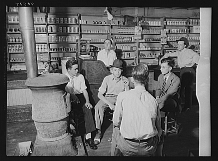 8. The interior of a general store in Granville. The boys are dressed up for election day. 1940.
