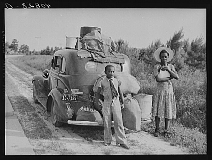 14. Florida migrants passing through North Carolina stop and pose for a picture on their way to Cranberry, New Jersey, to work on a potato farm.