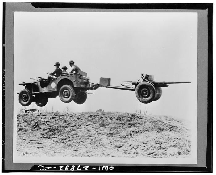 5. Bantam Car in mid-air in 1940's Onslow. Looks like fun.