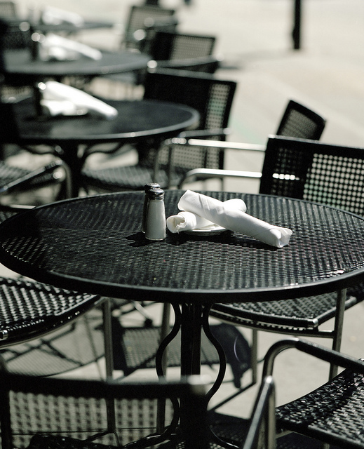 9. There is something very dramatic about this beautifully taken picture of empty tables at a cafe.