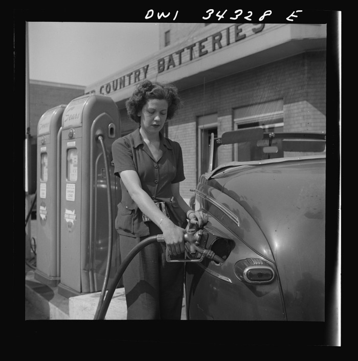 12. A women working at a gas station in 1943.