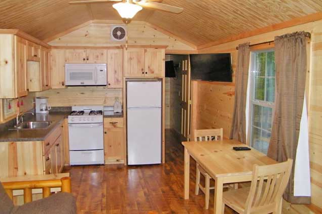 Cabins sleep six comfortably and offer full kitchens, private bathrooms, air conditioning, fire rings, flat screen televisions and free wifi access.