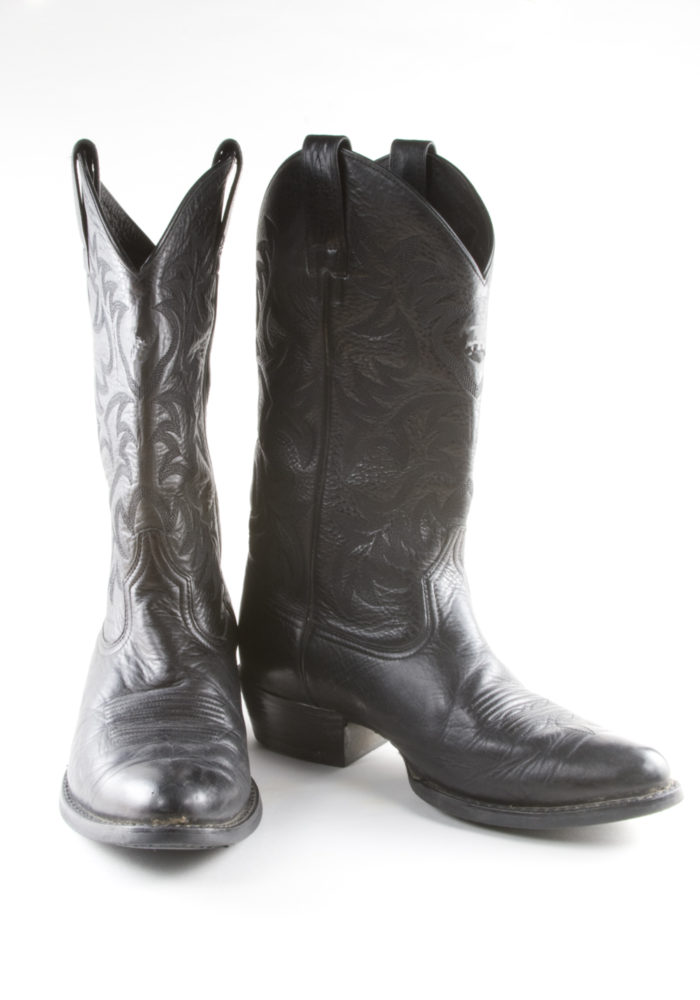 2. They're wearing fresh, clean cowboy boots with their street clothes.