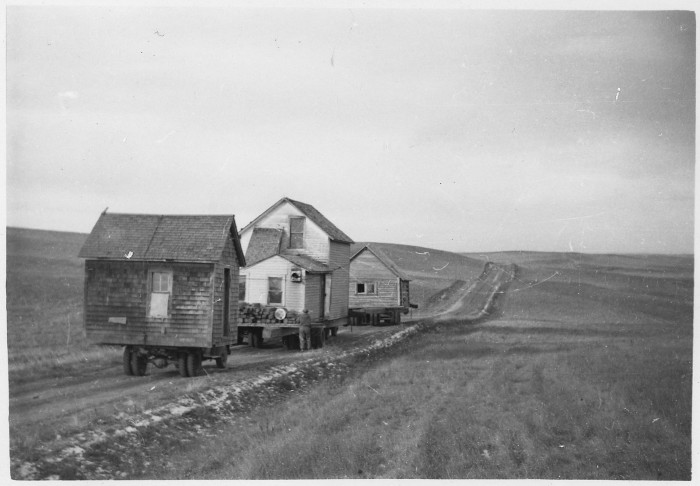 1. Buildings being moved to a new location after a flood - 1952