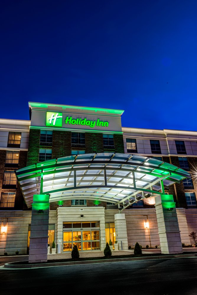 Check in at Holiday Inn Downtown at 701 West 1st Street.