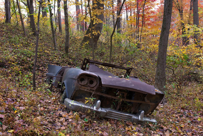 An abandoned car eerily sits among the ruins. Yet it somehow fits in with the mood of the surrounding area.