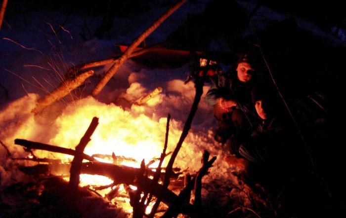 11. Afterschool hangouts sometimes consist of making a fire on a frozen beach.