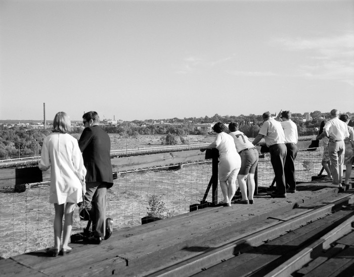 6. Locals gather to watch flooding (1969)
