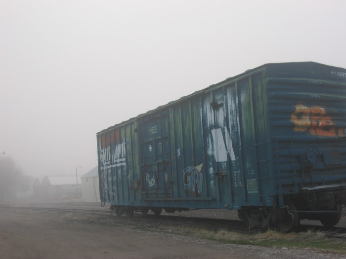 13. An old abandoned train car in Missoula on a foggy day.