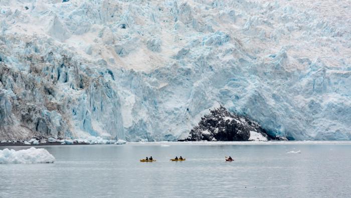Kayakers in front of Aialik Glacier, Kenai Fjords National Park