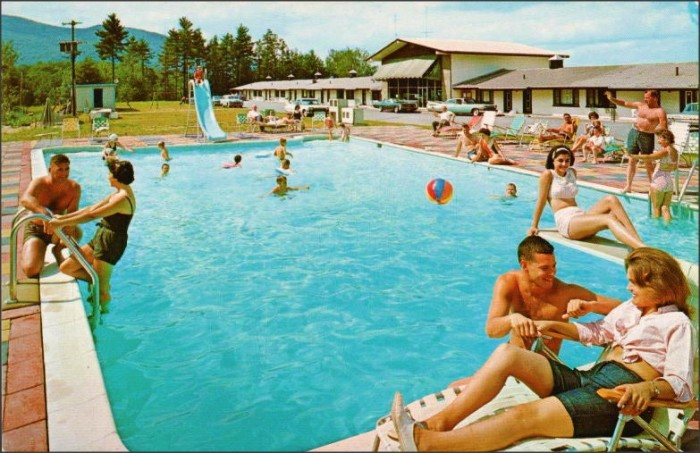 2. New York residents enjoying the summer weather by the pool in Lake George.