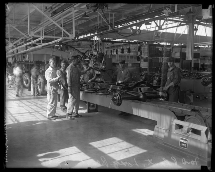 8. Hard at work at the Ford assembly line in Long Beach.
