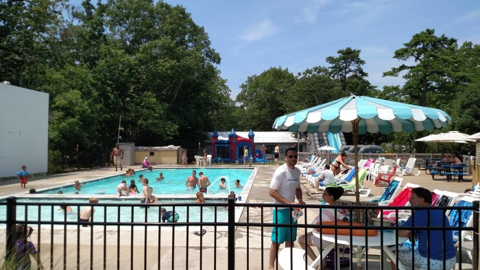 Property amenities include a swimming pool, outdoor theater area, volleyball courts, horseshoes, a playground, rec hall, inflatables and water slides, skate park and nature trails.