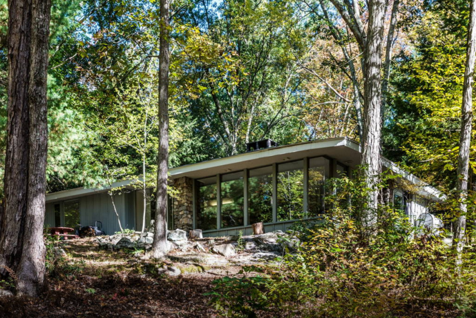 5. This modern masterpiece is as close as you can get to a tree house without having to climb a ladder. Panoramic views of the woods are amazing.