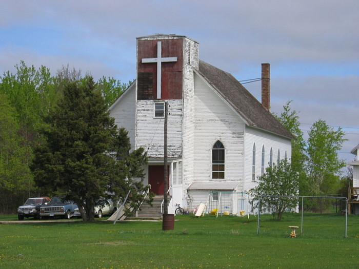 The church stuck around after the railroad was abandoned in the early 1970s, but in 2014 it burned down.