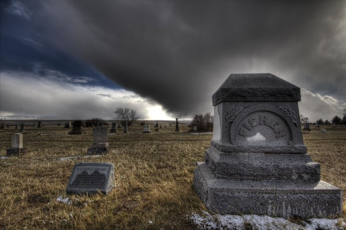 9. A storm approaching a cemetery.